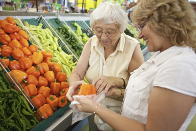 two elderly women at grocery store